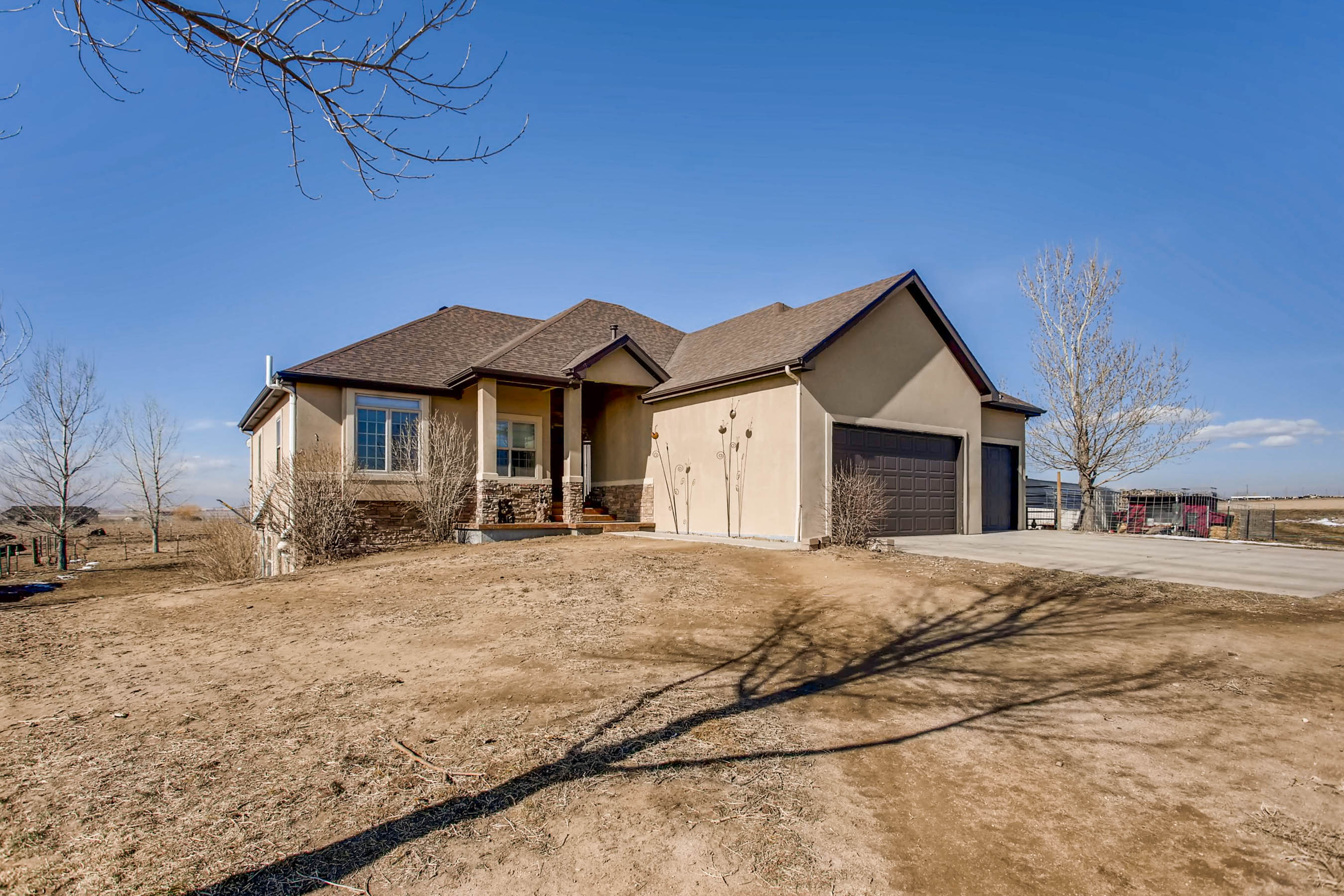 Custom built farmhouse with a barn fort collins real for Custom built barn homes